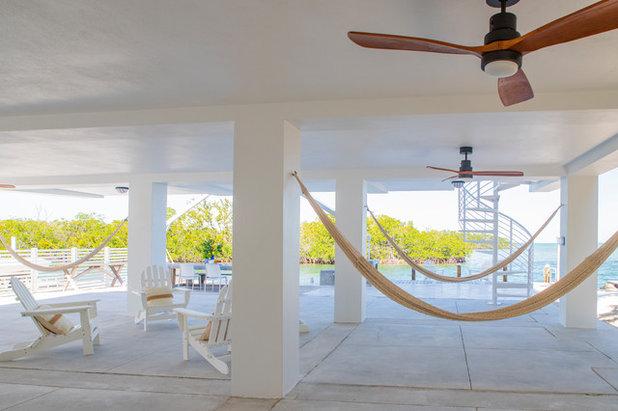 Beach Style Exterior by Interiors by Maite Granda