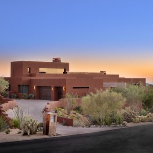 Design ideas for a mid-sized contemporary two-storey stucco brown house exterior in Phoenix with a flat roof and a green roof.