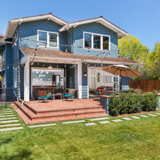 Inspiration for a craftsman blue two-story mixed siding exterior home remodel in San Francisco with a shingle roof