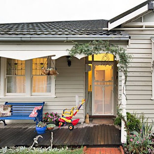 Mid-sized beach style white one-story metal exterior home idea in Melbourne with a tile roof