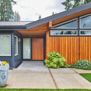 Mid-sized 1960s gray one-story exterior home photo in Seattle with a metal roof
