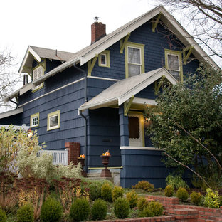 Small traditional two-story wood exterior home idea in Seattle