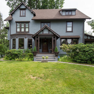 Inspiration for a mid-sized timeless blue three-story stucco gable roof remodel in Atlanta