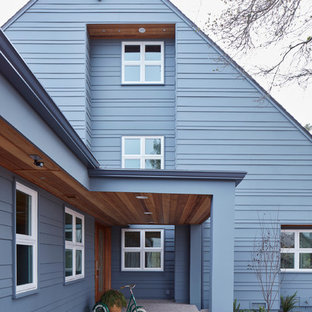 Example of a large danish gray two-story concrete fiberboard exterior home design in San Luis Obispo with a shingle roof