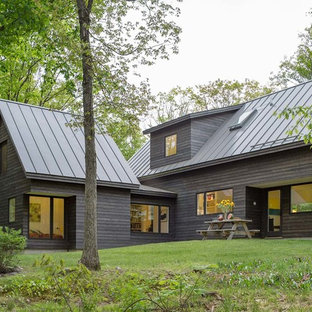 Mid-sized contemporary brown one-story wood exterior home idea in Burlington with a metal roof