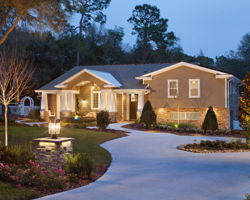 Example of an arts and crafts brown split level exterior home design in orlando