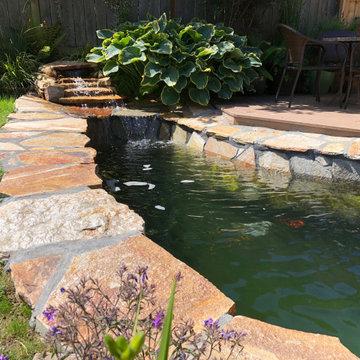 Koi pond installation with flagstone patio