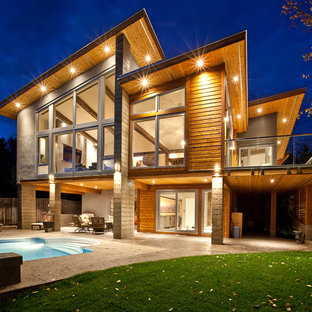Inspiration for a contemporary brown two-story mixed siding flat roof remodel in Vancouver