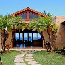 Tropical Exterior by Fine Design Interiors, Inc