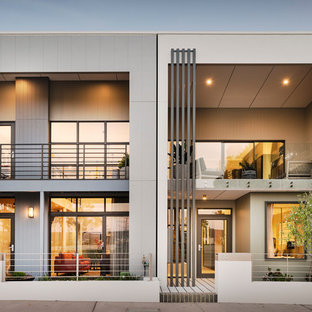 Design ideas for a contemporary two-storey grey townhouse exterior in Perth with a flat roof.