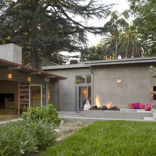 This is an example of a large and gey contemporary one floor render exterior in Los Angeles with a lean-to roof.