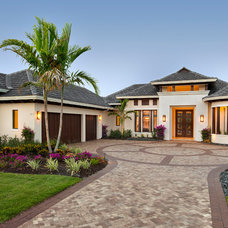 Tropical Exterior by Castle Harbour homes