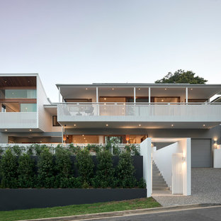 Inspiration for a contemporary two-storey white house exterior in Brisbane.