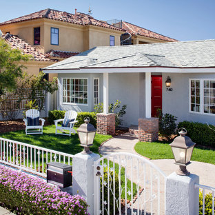 Mid-sized beach style gray one-story stucco gable roof photo in San Francisco