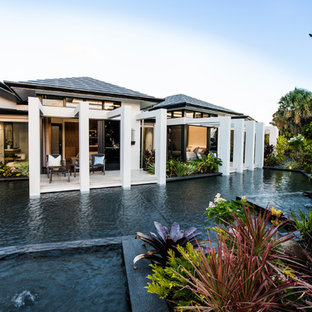 Huge island style white two-story glass exterior home photo in Gold Coast - Tweed with a hip roof