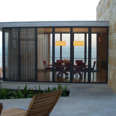 Modern Exterior by Tommy Chambers Interiors, Inc.