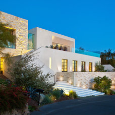 Contemporary Exterior by Ron Neal Lighting Design