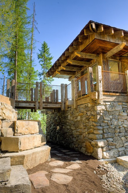 Rustic Exterior by Bear Mountain Builders