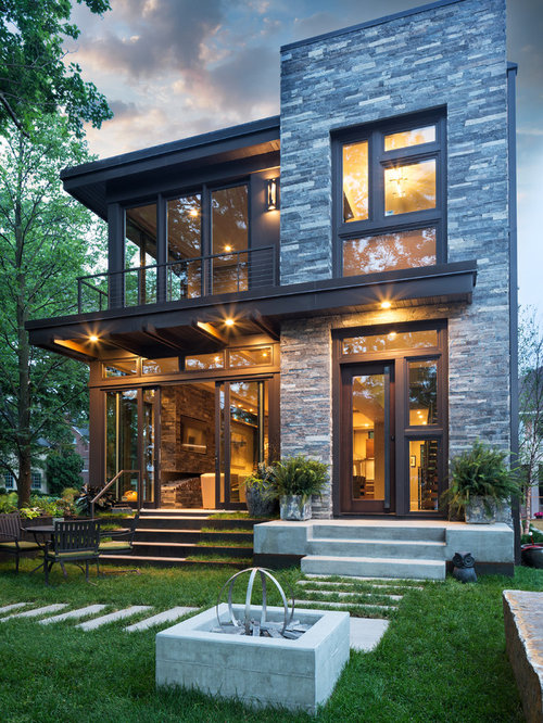 Inspiration for a small contemporary gray two-story mixed siding flat roof  remodel in Minneapolis