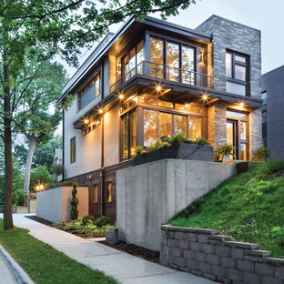 Inspiration for a large contemporary gray three-story mixed siding flat roof remodel in Minneapolis