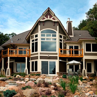 Example of a mountain style two-story wood exterior home design in Minneapolis