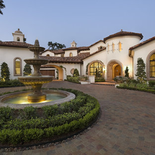 Example of a large tuscan exterior home design in Austin with a tile roof