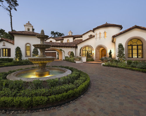 Colonial Spanish Exterior   Houzz Example of a large tuscan exterior home design in Austin with a tile roof. Spanish Home Design. Home Design Ideas