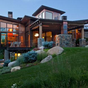 Example of a zen exterior home design in Denver