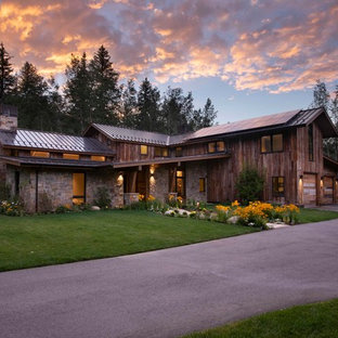 Inspiration for a rustic brown two-story mixed siding exterior home remodel in Denver with a metal roof