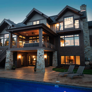 Design ideas for a large country exterior in Minneapolis with three or more storeys and stone veneer.