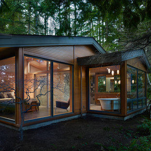 Mid-sized 1960s one-story wood gable roof idea in Seattle