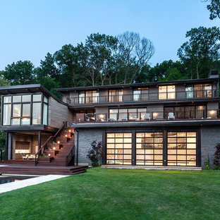 This is an example of a gey contemporary detached house in Chicago with three or more floors.