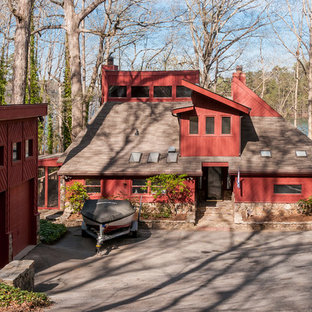Mid-sized trendy red two-story mixed siding house exterior photo in Atlanta with a shed roof and a shingle roof