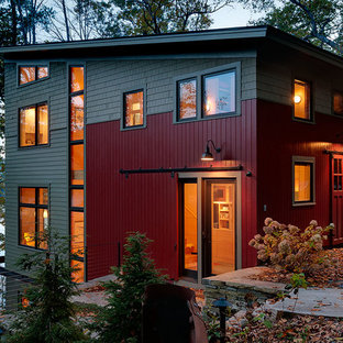 Inspiration for a contemporary three-story exterior home remodel in Burlington