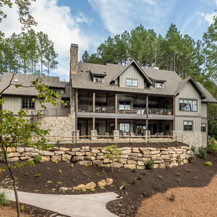 Example of a huge mountain style gray three-story exterior home design in Other with a shingle roof
