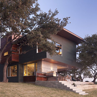 Large trendy multicolored two-story metal flat roof photo in Austin