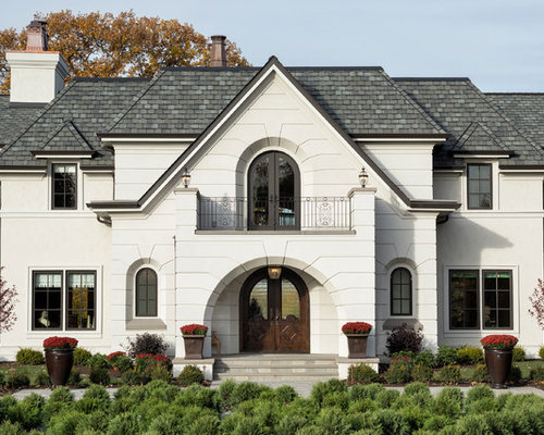 Example Of A Large Classic White Two Story Stucco Exterior Home Design In  Minneapolis With