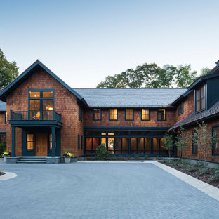 Inspiration for a huge craftsman brown two-story wood exterior home remodel in Minneapolis with a mixed material roof
