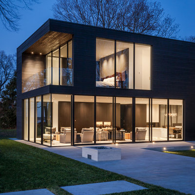 Large modern two-story wood house exterior idea in Minneapolis