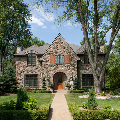 Traditional stone exterior home idea in Detroit