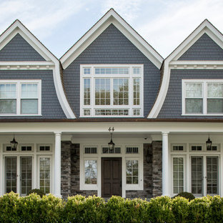 Large traditional blue two-story wood exterior home idea in New York with a gambrel roof