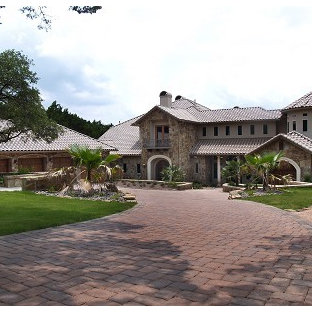 Example of a tuscan exterior home design in Austin