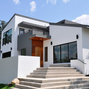 Mid-sized contemporary white two-story stucco exterior home idea in Austin with a shed roof