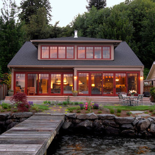 Example of a mid-sized coastal brown two-story exterior home design in Seattle