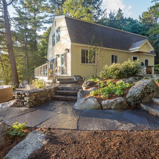 Mid-sized craftsman yellow two-story vinyl exterior home idea in Burlington with a gambrel roof