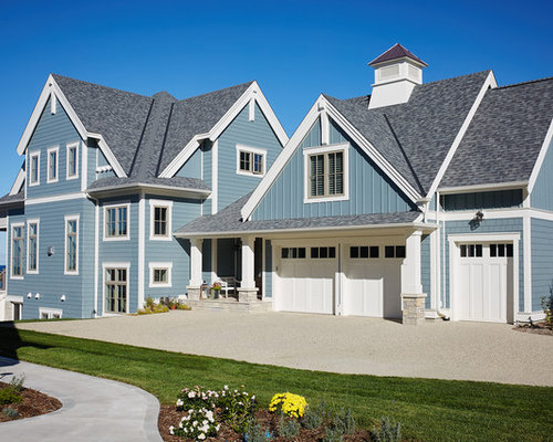 Example Of A Coastal Blue Three Story Mixed Siding Gable Roof Design In Grand  Rapids