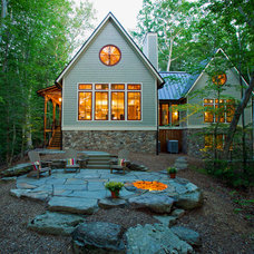 Rustic Exterior by KohlMark Architects and Builders