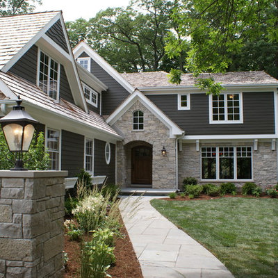 Example of a classic gray two-story mixed siding exterior home design in Chicago