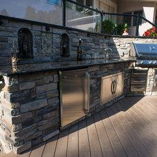 Traditional Exterior by Elemental Design & Bloom Garden Center