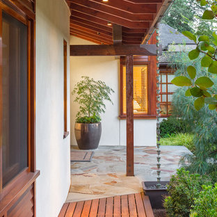 Example of an asian exterior home design in Other